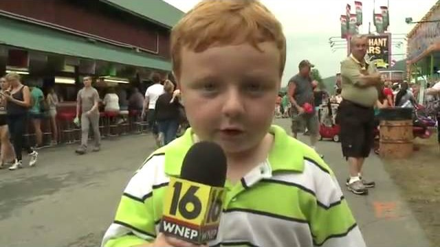 Apparently This Kid Is Awesome: Steals The Show During Interview At Amusement Park!