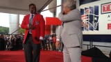 Ty Law and Robert Kraft break dance at Patriots HOF
